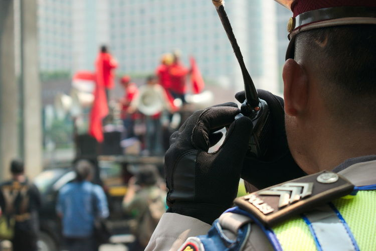 May Day march in Jakarta. Close-up Day Flags Focus On Foreground Labor Day March Mayday  Occupation Outdoors Police Police Force Protest Protest Signs Protesters Protesting Real People Red Riots Security Speak Speak Up Technology Uniform The Photojournalist - 2017 EyeEm Awards