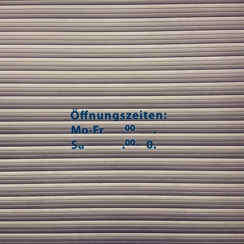 Text on corrugated shutter