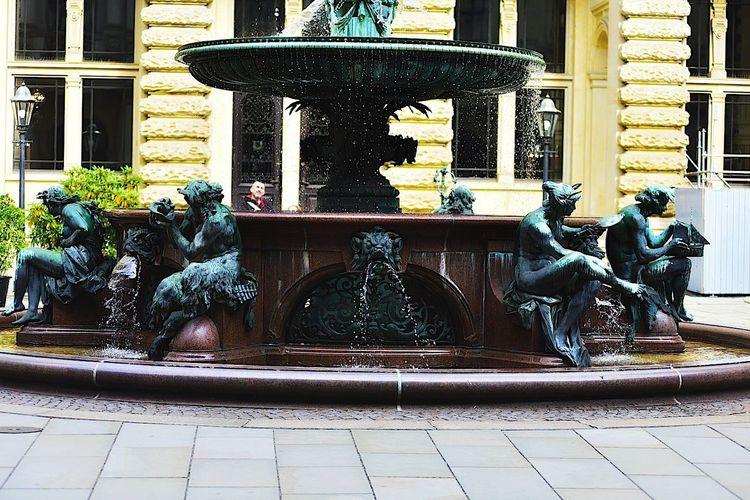 Statue fountain against building