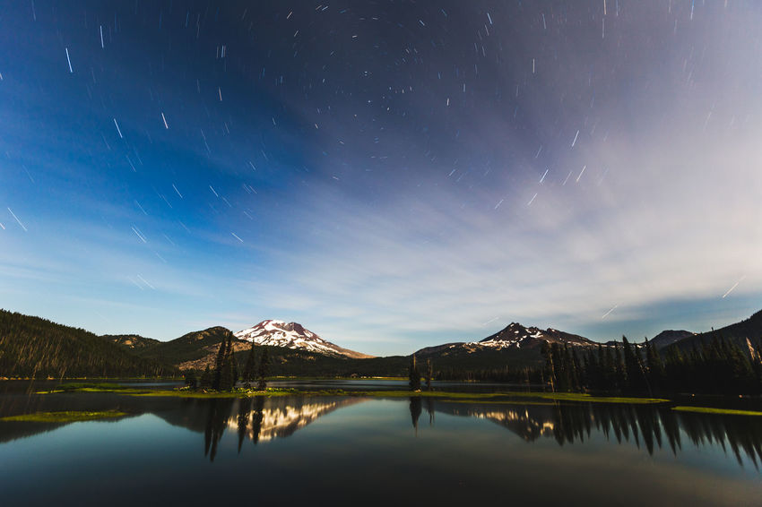 Star trails over Sparks Lake near Bend, Oregon, USA. EyeEmNewHere Long Exposure Shot Oregon Astronomy Beauty In Nature Galaxy Lake Long Exposure Mountain Nature Night Outdoors Reflection Scenics Sky Star Star - Space Tranquil Scene Tranquility Water Waterfront