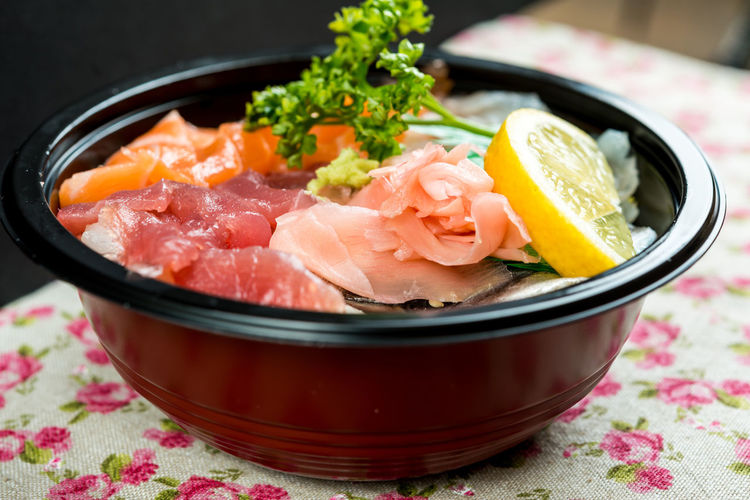 Close-up of chirashi served in bowl on table at home