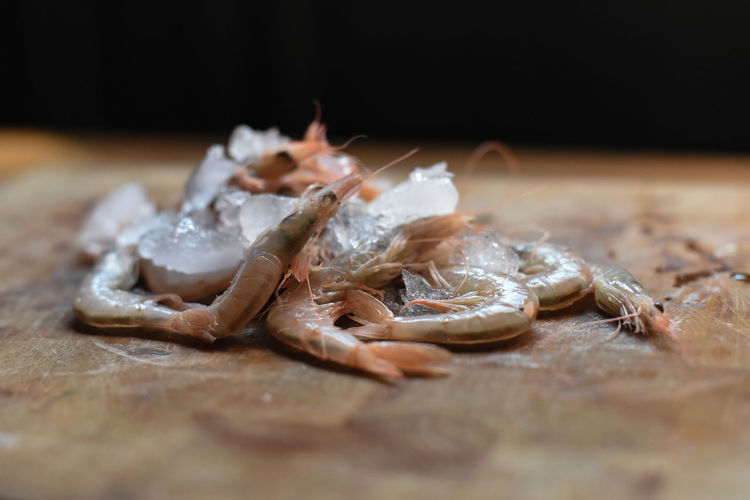 Close-up of fresh frozen shrimps on table