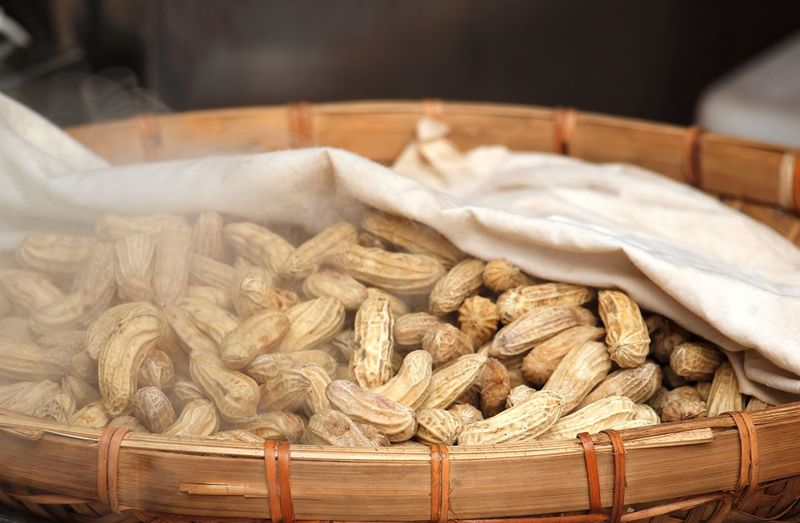 High angle view of boiled peanuts in wicker basket