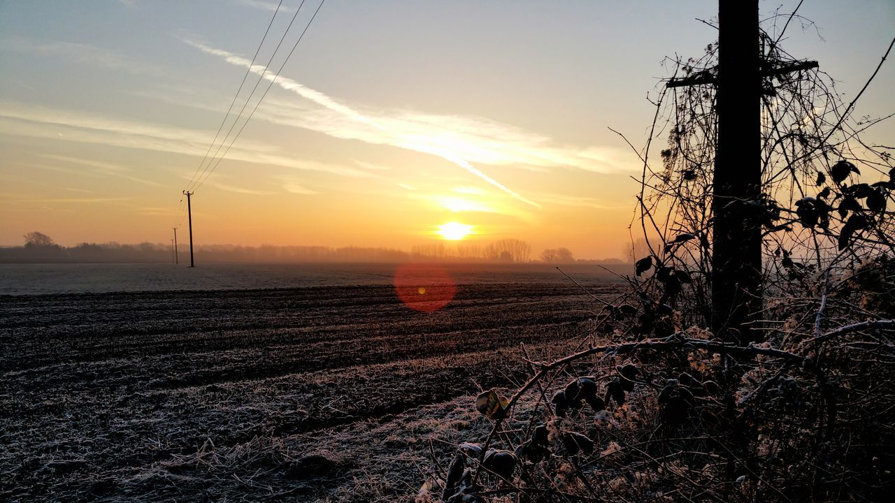 sunset, field, sky, nature, no people, tranquility, tranquil scene, landscape, beauty in nature, outdoors, scenics, fuel and power generation, agriculture, cable, rural scene, electricity pylon, day