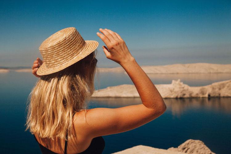 Woman wearing hat against sky
