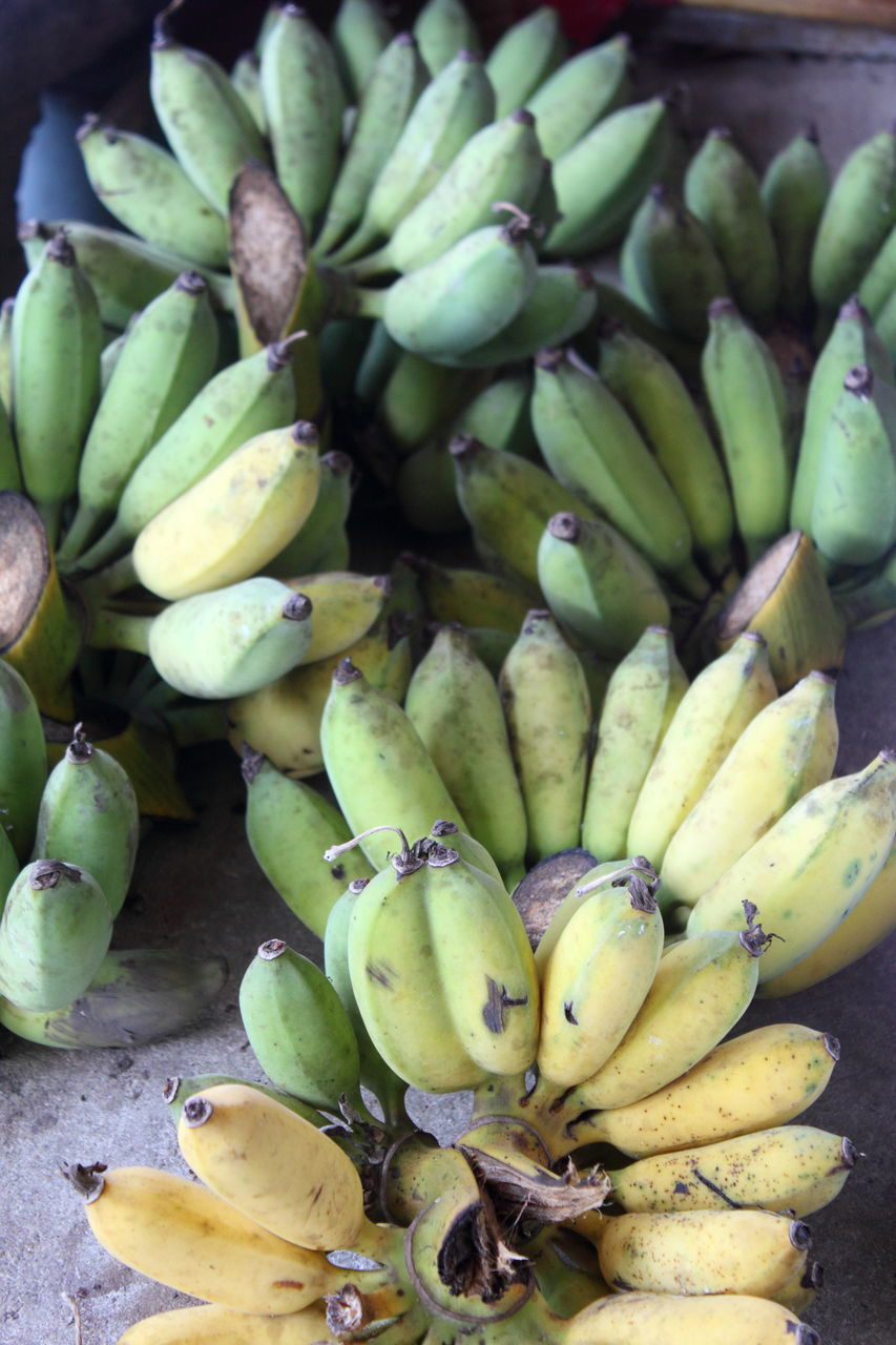fruit, food and drink, food, banana, healthy eating, green color, freshness, abundance, large group of objects, no people, high angle view, day, market, close-up, outdoors