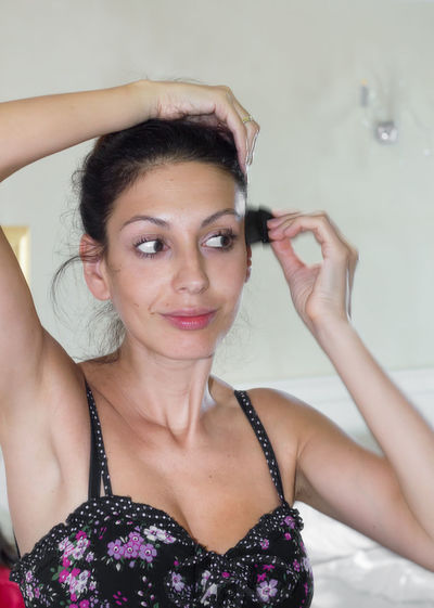 Woman combing hair at home
