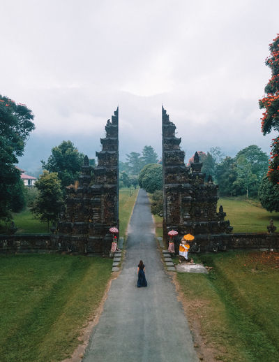 Drone shot girl in Bali Architecture Plant Sky Built Structure Building Exterior Nature Travel Tourism Travel Destinations People Religion Lifestyles Ancient Civilization Woman Girl Walking Dress Long Dress Drone  Drone Photography Bali North Gate Lifestyle Travel