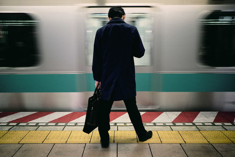 Tokyo. Blurred Motion Day Full Length Indoors  Journey Lifestyles Men Mode Of Transport Motion One Person Passenger Train Public Transportation Rail Transportation Railroad Station Railroad Station Platform Real People Rear View Standing Station Subway Train Train - Vehicle Transportation Travel Waiting Women