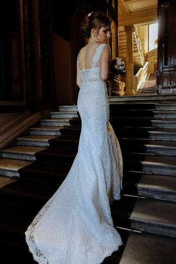 Adult Architecture Beautiful Woman Beauty Bride Celebration Clothing Dress Train Event Fashion Hairstyle Indoors  Newlywed One Person Real People Staircase Standing Steps And Staircases Wedding Wedding Ceremony Wedding Dress Wedding Dress Train Women Young Adult Young Women