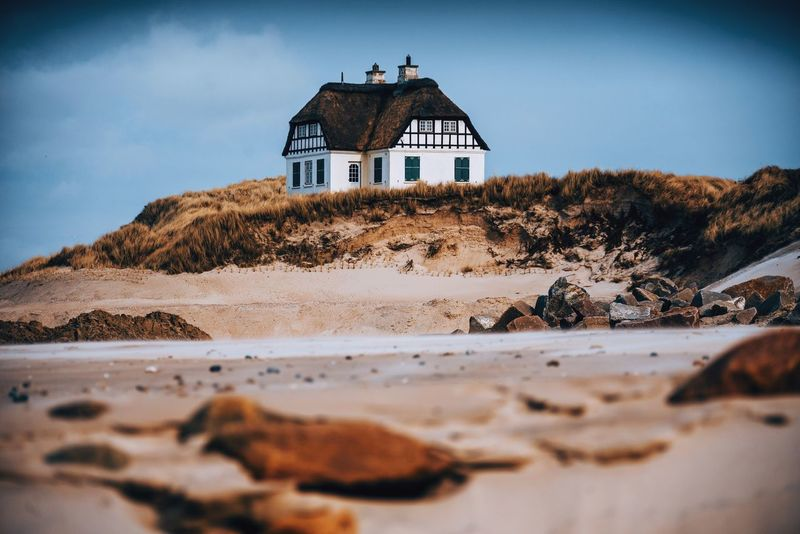 Cozy living in Denmark Denmark Architecture Built Structure Land Building Exterior Sky Beach Building Nature Sand No People Scenics - Nature Day Cloud - Sky Water House Tranquility Tower Tranquil Scene Sunlight Surface Level