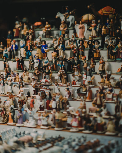 Human Representation Large Group Of Objects Art And Craft Selective Focus Table Choice Still Life No People High Angle View Variation Representation Arrangement Creativity Retail  For Sale Male Likeness Abundance Collection