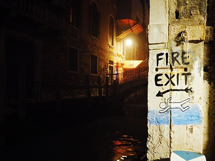 Building Exterior Built Structure Architecture Text Fireexit Fire Exit Swimming Illuminated Night Communication Road Sign Graffiti Water City Venice Venezia Venice, Italy