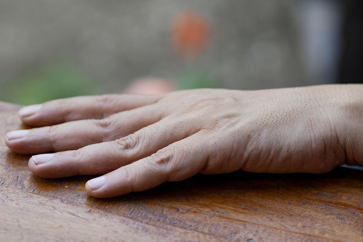 Close-up of hands on table