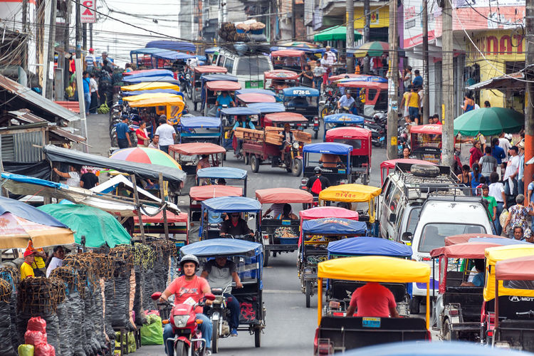 IQUITOS, PERU - MARCH 17: Heavy traffic in the Belen market in Iquitos, Peru on March 17, 2015 Amazon Amazonas Amazonian Belén Brazil City Cityscape Destination Iquitos  Iquitos, Perú Landscape Marketplace Motorcycle People Peru Peruvian Port Rainforest South America Street Taxi Traffic Transportation Travel Tropical
