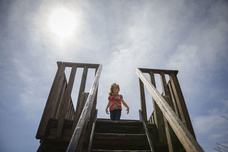 Little girl climbing to a wooden observation tower in a wetland in Padul, Granada, Andalusia, Spain Built Structure Casual Clothing Child Childhood Cloud - Sky Day Females Girls Hairstyle Leisure Activity Lifestyles Little Girl Low Angle View Nature One Person Outdoors Real People Sky Women