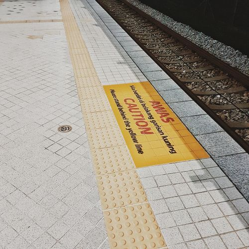 High angle view of text on railroad platform
