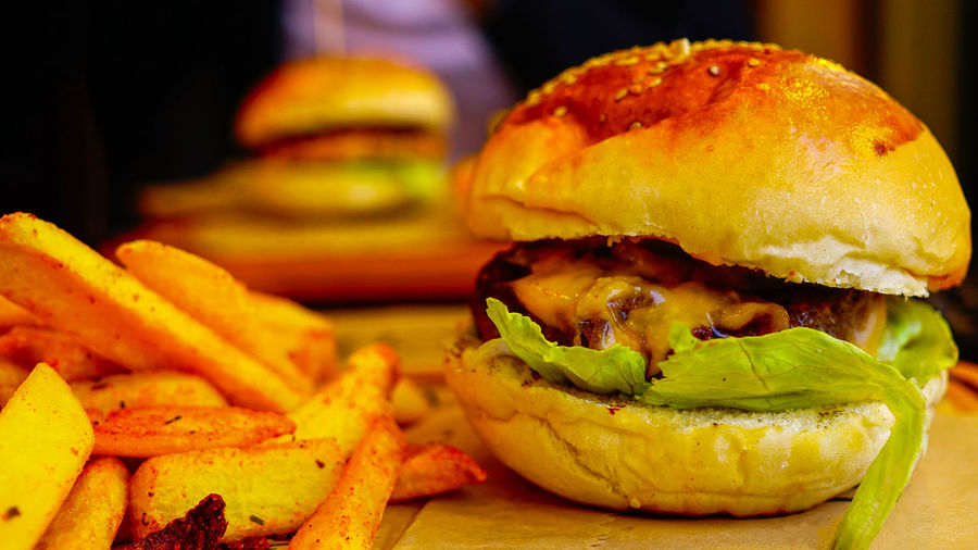 Burger Sandwich Fast Food Unhealthy Eating Ready-to-eat Hamburger Food And Drink Close-up Food Freshness French Fries Prepared Potato Potato Fried Focus On Foreground Still Life Meat Indoors  Bread No People Take Out Food Bun Snack Temptation Fast Food French Fries