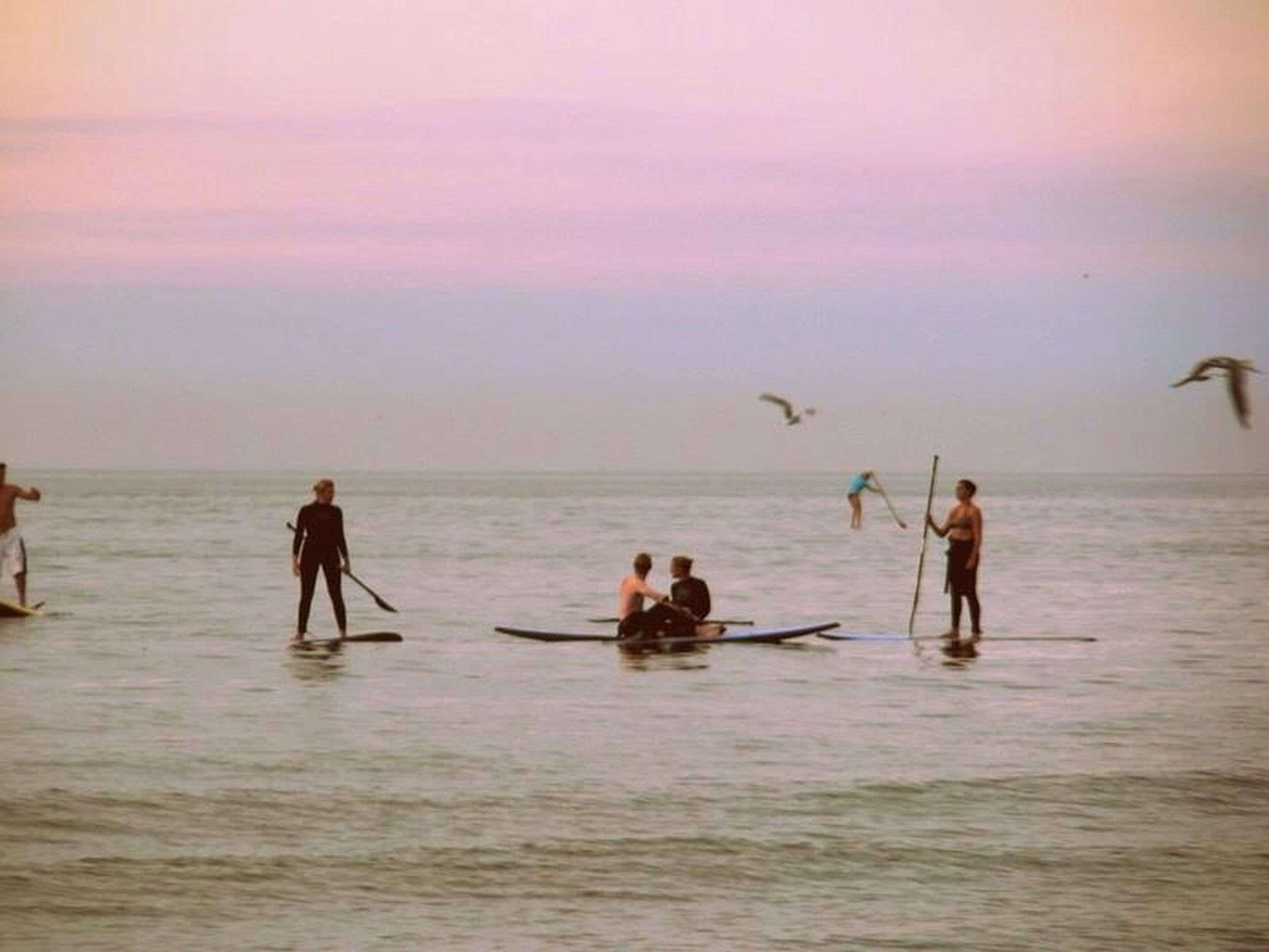 sea, water, horizon over water, leisure activity, lifestyles, beach, togetherness, vacations, men, enjoyment, waterfront, sunset, person, sky, shore, nature, beauty in nature, scenics, bonding