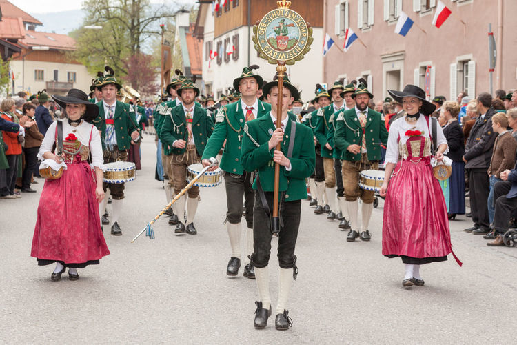 Miesbach, Bavaria, Germany, 04 May 2014: Company of the mountain troops from Garmisch with laughing brand Dente gutters Garmisch Garmisch-Patenkirchen Mountain Protect Kompanie Patronatstag Adult Adults Only Celebration Feast Day Full Length Large Group Of People Men Miesbach Mountain Protect Garmisch Music Musical Instrument Musician Outdoors Pageant Parade People Performance Period Costume Tradition Traditional Well-dressed