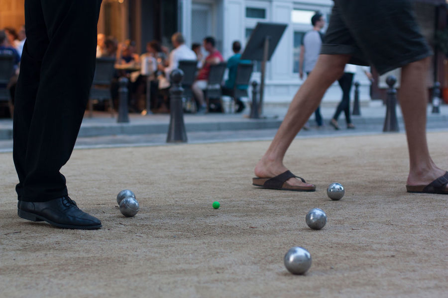 Boule on Place Dauphine Ball Boule Capital City Europe Feet France French Fun ILE DE LA CITE Leisure Activity Lifestyles Paris Petanque Place Dauphine Real People Standing Travel