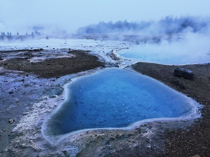 Close-Up Of Hot Spring Against Sky