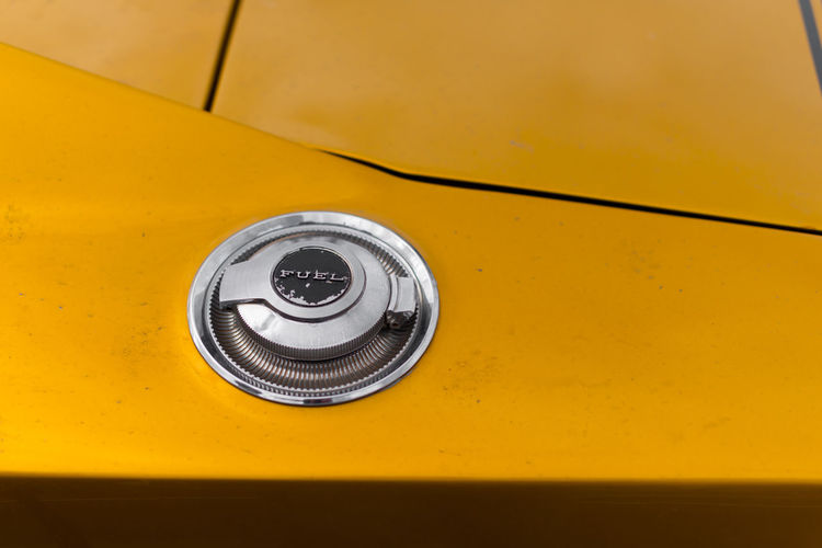 Close-up of fuel tank on yellow car
