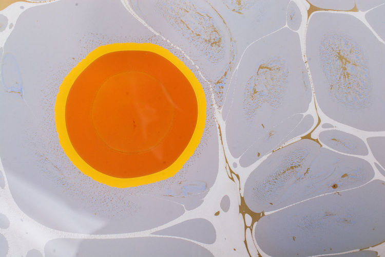 High angle view of yellow paint on water