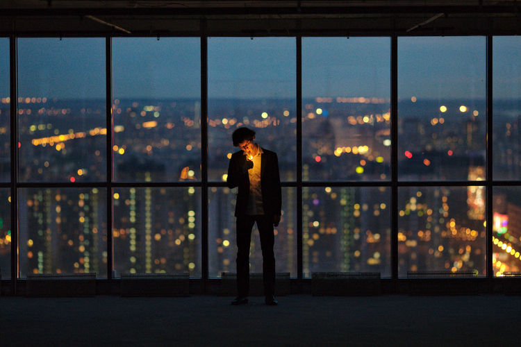 Self-portrait in Leader Tower. Alone Flooring Glass Glass - Material High Indoors  Lighter Lights Night Night City Night Lights Night View Self Portrait Selfie Smoke Smoking Standing Transparent Window