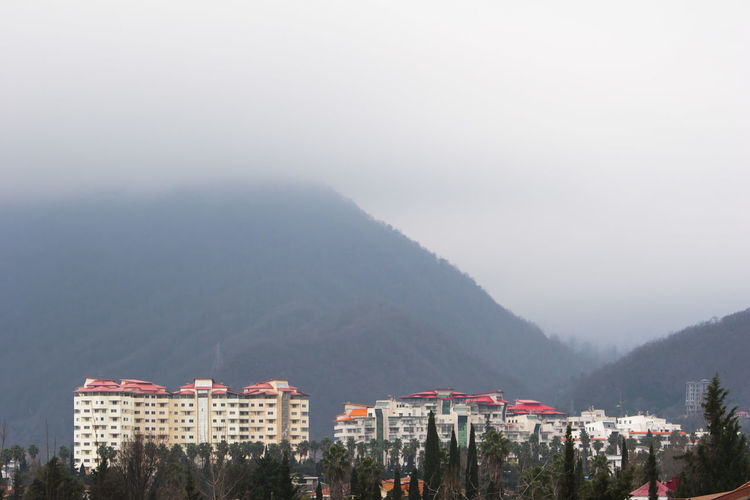 North of Iran,Ramsar City. Building Exterior Architecture Built Structure Mountain Building Sky Residential District Nature Mountain Range Fog No People Tree City Day Beauty In Nature Scenics - Nature Outdoors Plant Cityscape Iran Mazandaran Iran Ramsar Canon20d North Of Iran Architecture Iranian Architecture