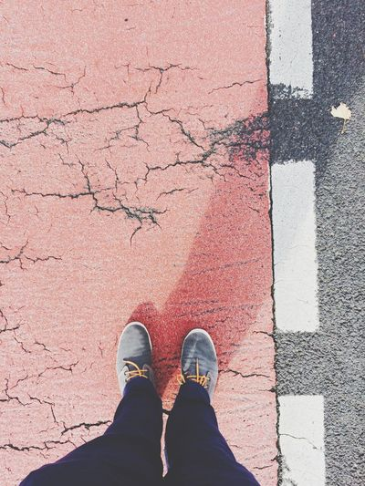 Low Section of Man Standing On Cracked Street