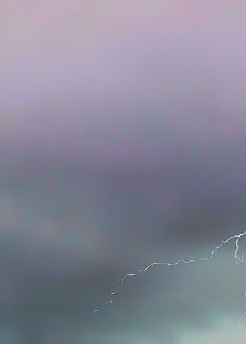 It looks like a scratch on a negative. But, this is a thin sliver of silver lightening against storm clouds. Stormy Weather Lightening Lightening Bolt Weather Beauty In Nature Low Angle View Backgrounds No People