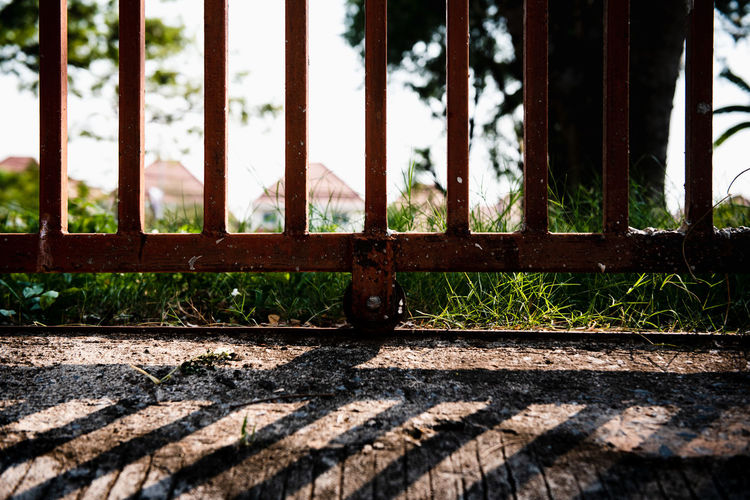 Shadow with light Day Sunlight No People Metal Nature Shadow Rusty Outdoors Close-up Focus On Foreground Plant Railing Grate Architecture Selective Focus Window Metal Grate Abandoned Wood - Material Steel Street EyeEm Best Shots WeekOnEyeEm Nikonphotography Vintage