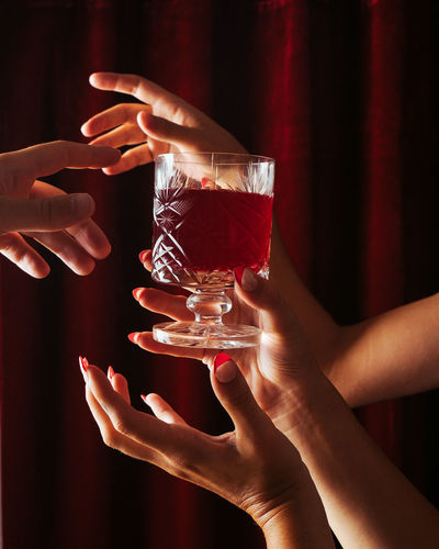 Close-up of hand holding drink
