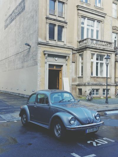 Car in front of building