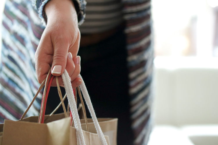 Woman carrying shopping bags City Fashion Paper Bag Shopping Bags Black Friday Buying Carrying Bag Consumerism Customer  Enjoyment Holding Bags Mall Paper Bags Retail  Sales Shop Shop Till You Drop Shopping Bags Shopping Mall Store Striped