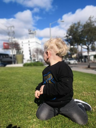 #looktheotherway Curly Hair Looking Away City Blond Hair Child Sitting Childhood Portrait Sky Architecture