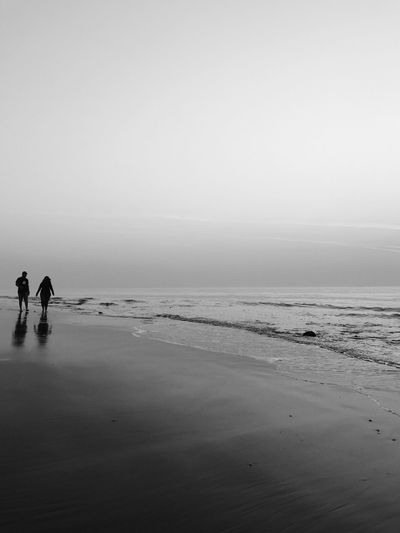 Beach Sea Low Tide Silhouette Vacations Travel Destinations Sand Tranquility Outdoors Water People Scenics Nature