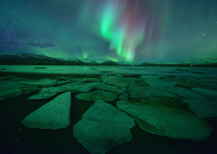 Beautiful aurora over famous diamond beach at night,night landscape, iceland