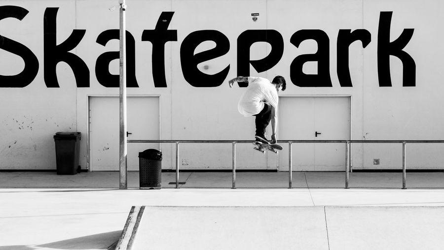 Man Skateboarding At Park Against Wall