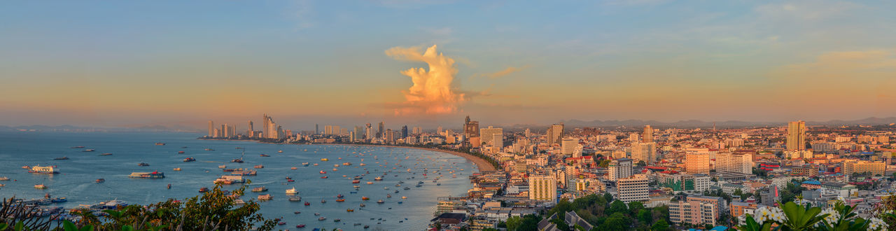 panorama view Pattaya Beach in thailand Building Exterior Architecture City Cityscape Built Structure Sunset Building Nature Water Cloud - Sky Residential District High Angle View Panoramic Sea Crowd Orange Color Crowded Outdoors Office Building Exterior Skyscraper Sky Panorama