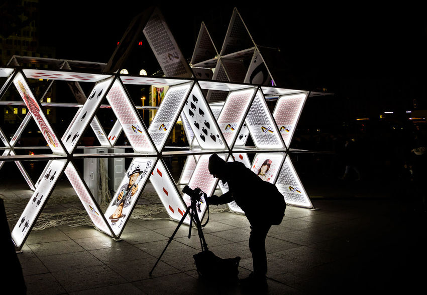 Light festival in Berlin 2015. Photographer taking images of play cards on camera connected to tripod Architecture Black Jack Cassino Construction Frozen Gulliver Hazard Hobby House Of Cards Interest Light Festival Long Exposure Night Pattern Play Cards Poker Shadow Shape Street Photo Tourism Destination Tripod Photography Urban