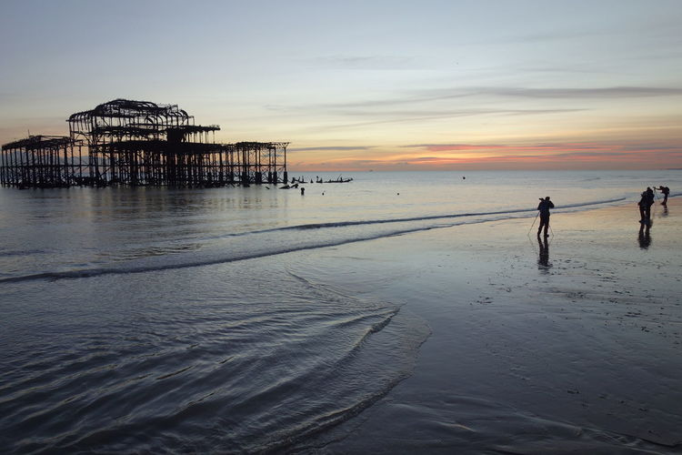 Brighton Palace Pier Amidst Sea During Sunset