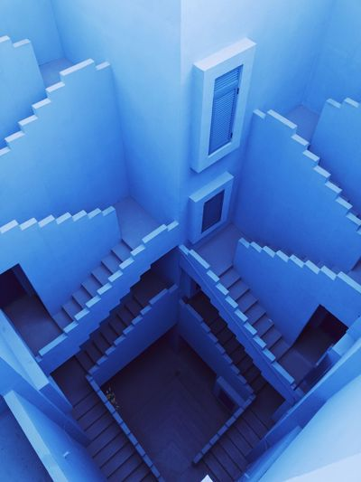 deep in blue Blue Minimal Maze Bofill EyEmNewHere Eyem Staircase Steps And Staircases Steps Spiral High Angle View Railing Shades Of Winter No People Stairs Architecture EyeEmNewHere The Architect - 2018 EyeEm Awards