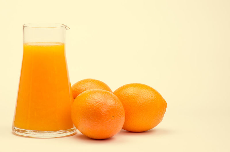 oranges and juice C Vitamin Breakfast Drink Drinking Glass Food And Drink Freshness Fruit Fruit Juice Glass Healthy Eating Indoors  No People Non-alcoholic Beverage Orange Orange - Fruit Orange Color Orange Juice  Orange Juice  Oranges Refreshment Ripe Still Life Studio Shot Wellbeing White Background