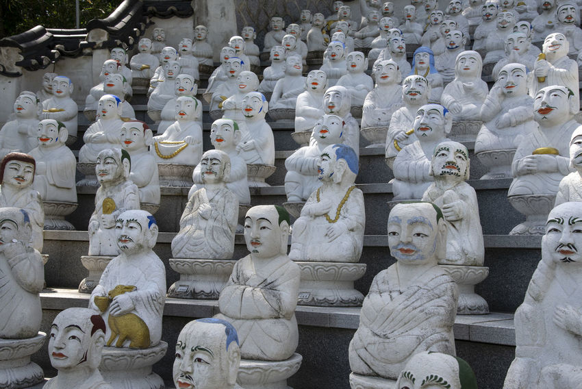 View of Bomunsa, a famous Buddhism temple at Seokmodo in Ganghwado, Kimpo, Gyeonggido, South Korea Bomunsa Buddhism Temple Seokmodo South Korea Architecture Art And Craft Belief Buddhism Craft Creativity Day Female Likeness Ganghwado Human Representation In A Row Large Group Of Objects Male Likeness No People Order Religion Representation Sculpture Side By Side Spirituality Statue Temple White Color