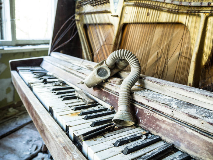 Close-up of an abandoned piano