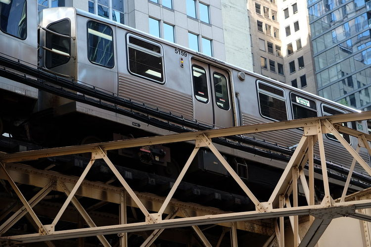 Chicago City Metro USA Architecture Bridge Building Building Exterior Built Structure Connection Day Low Angle View Metal Mode Of Transportation No People Outdoors Public Transportation Rail Transportation Railroad Car Street Photography Train Train - Vehicle Transportation Travel Urban