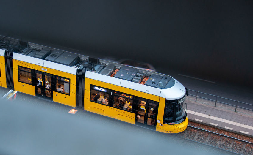 High angle view of yellow train on railroad station