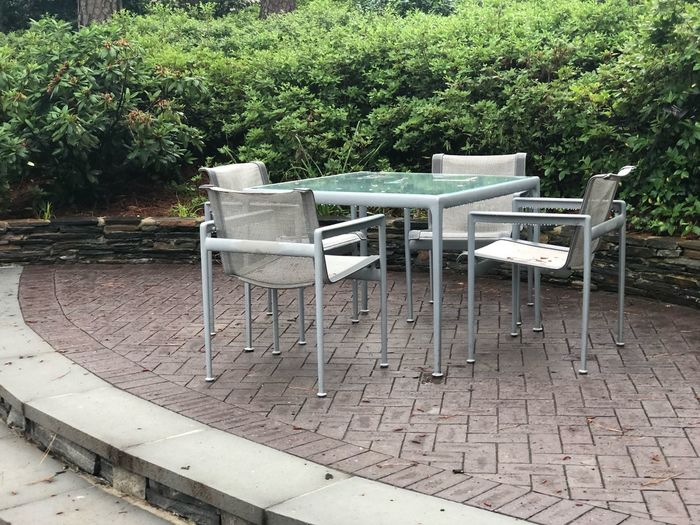 Outdoor seating area in the gardens Seat Plant Tree Chair Day Empty No People Green Color Footpath Bench Absence Park - Man Made Space Nature Park Growth Land Table Outdoors Grass Street